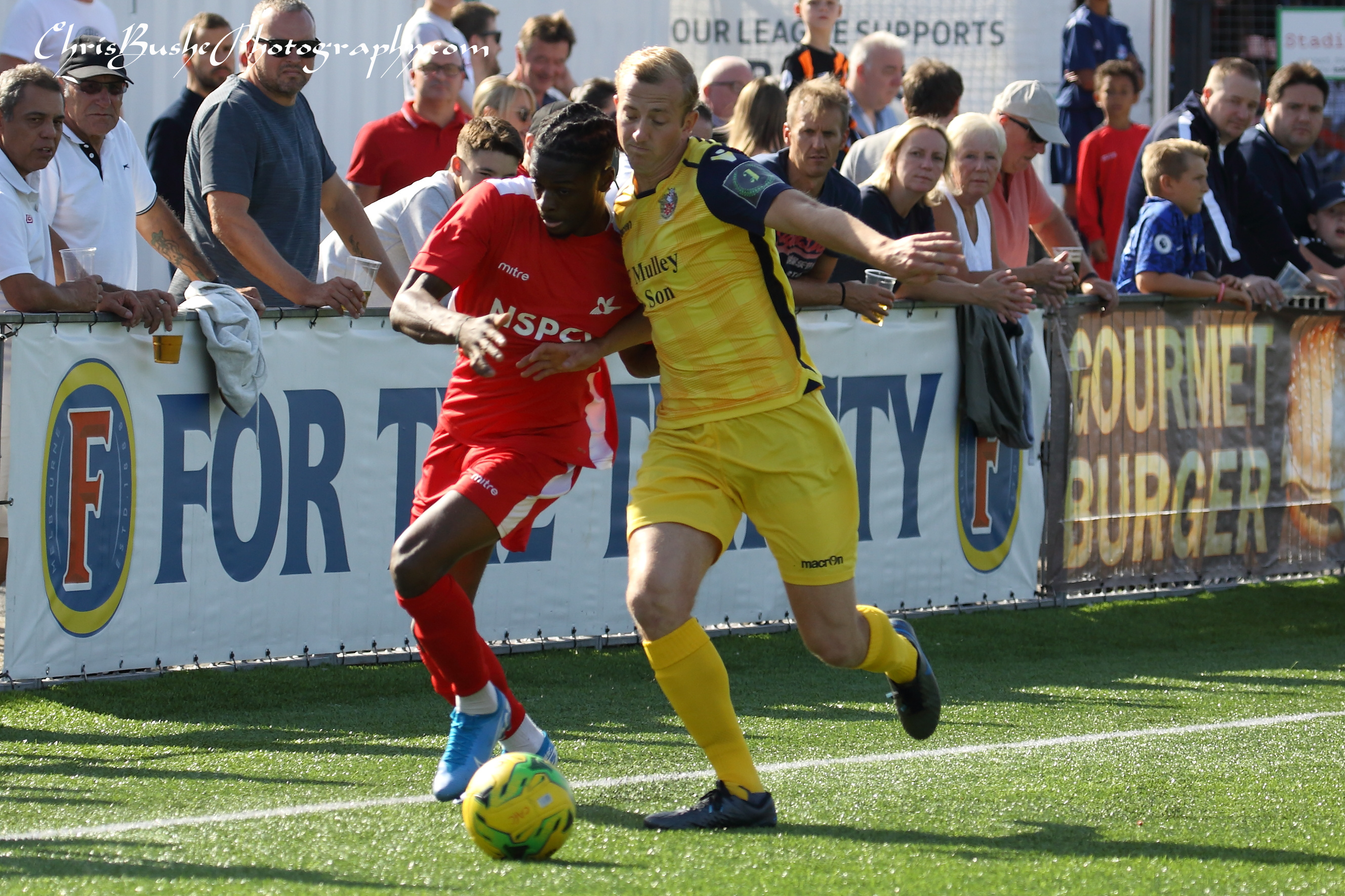 Mickey Parcell of Hornchurch and Jeremiah Amoo Carshalton battle down right wing